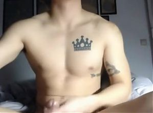 Handsome gay shows his naked body and plays with cock