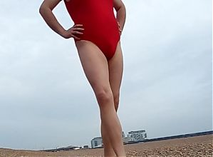 Me in Baywatch swimsuit at beach